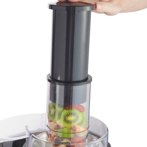 whole fruit juicer chute in action